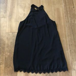 Black short dress with lace detail on bottom
